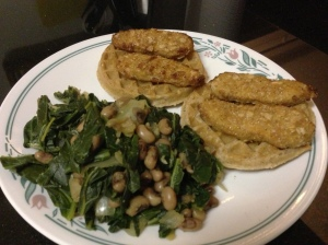 "Fried ""chicken"" (thanks Gardein) and waffles) with greens and beans just waiting for some hot sauce.  Happy New Year!"